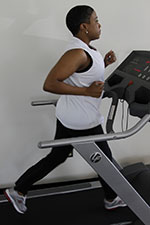 A cancer survivor exercising on a treadmill