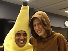 Annie Sampson and Meg Bertram pose for the camera, showing off their monkey and banana costume duo.