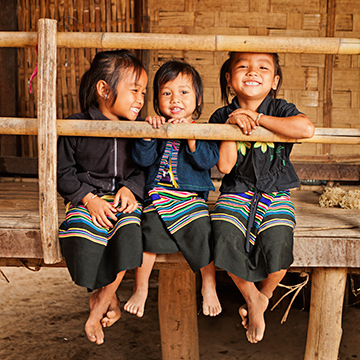Three Asian girls sitting and smiling