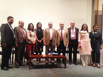 Representatives from NCI, CDC, WHO, and the Ministry of Health and Family Welfare of India pose for a photo to commemorate the release of the report, Smokeless Tobacco and Public Health: A Global Perspective