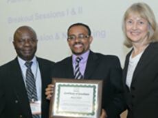 First place poster award winner Bisrat Debeb flanked by Dr. Peter Ogunbiyi and Dr. Mary Ann Van Duyn, CRCHD.