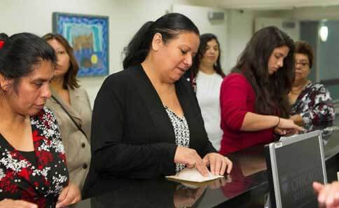 Members of the Latina community learn about breast cancer services offered by University of Chicago of Medicine