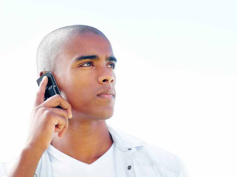 Young male on a cell phone
