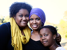 An African American woman and her two daughters.