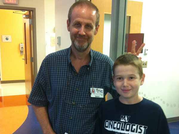 Brent Weston, M.D., and Harrison McKinion at UNC Lineberger Comprehensive Cancer Center
