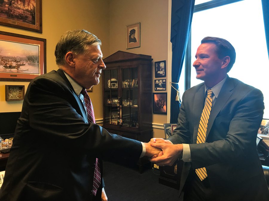 Photo of Representative Tom Cole and NCI Director Norman Sharpless.
