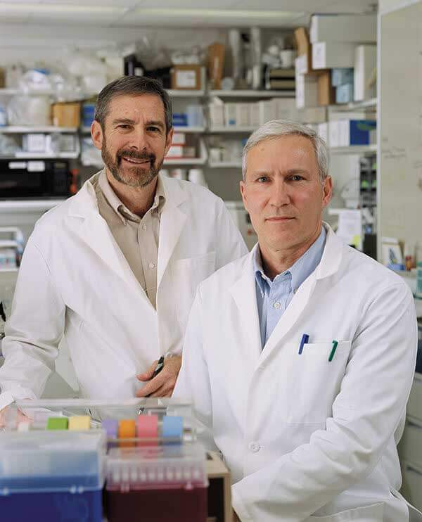 Photo of Douglas R. Lowy, M.D., and John T. Schiller, Ph.D., at NCI's Center for Cancer Research.