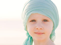 Young girl with a scarf wrapped around her head.