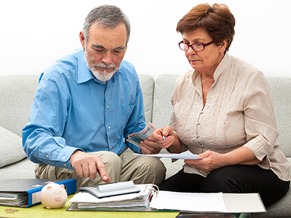 Older couple looking at financial documents