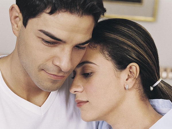 Hispanic Woman Resting Head on Hispanic Man