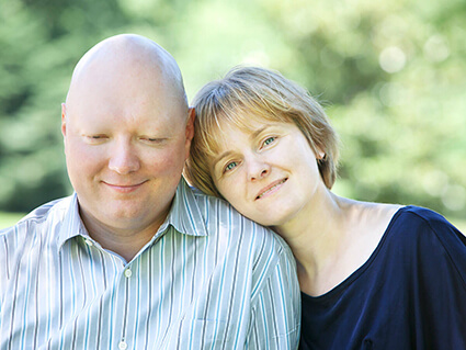 Bald Man with Cancer and his Wife