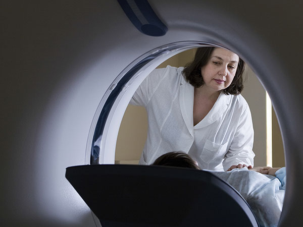 Doctor Examining Patient Before CT Scan