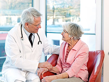 Doctor Reassuring Elderly Woman