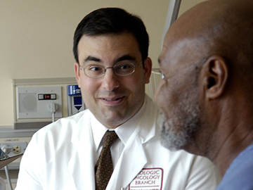 A Male Doctor Talking with a Male Patient
