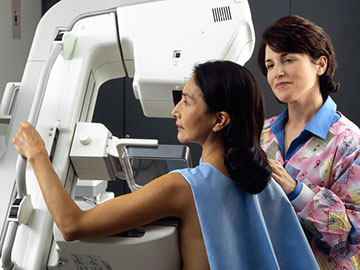 A woman getting a mammogram
