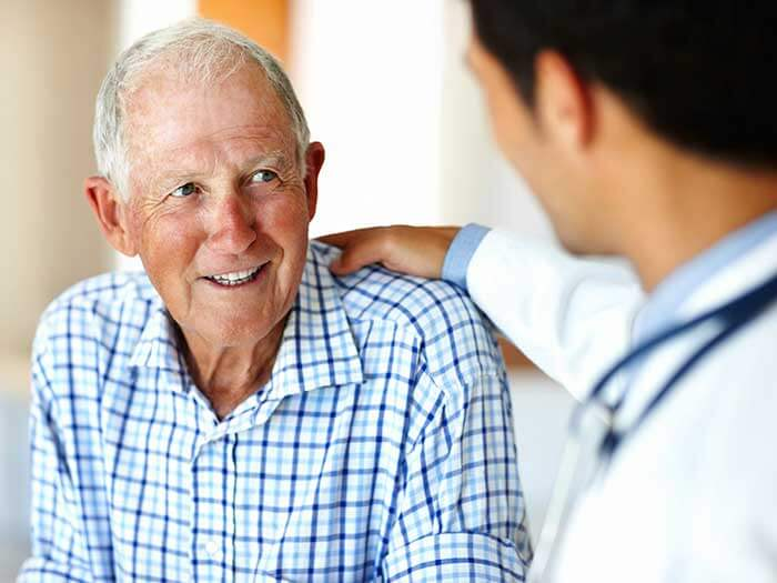 An Elder Man Smiling at a Male Doctor