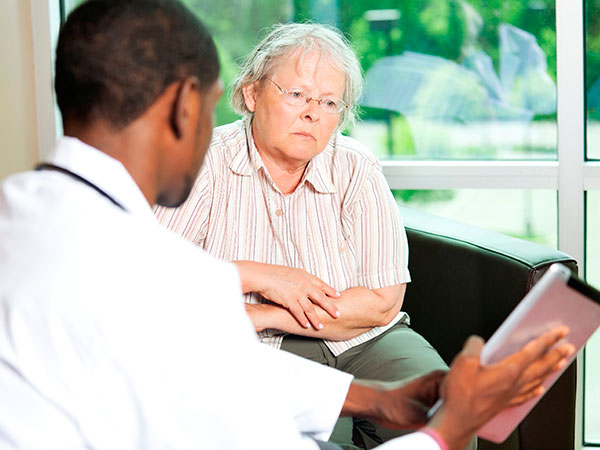 Older woman talking with a physician
