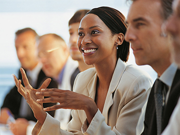 Woman Speaking in Business Meeting