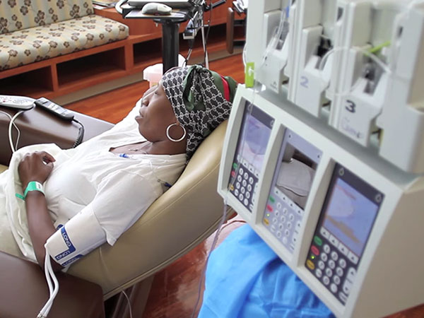 Woman wearing a headscarf getting chemotherapy treatment