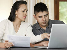 Woman and Man Looking at Laptop