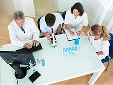 group of lab techs meeting at a table