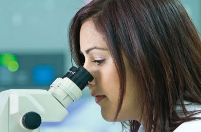 Woman Looking into Microscope