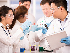 multi-ethnic group of scientists in lab