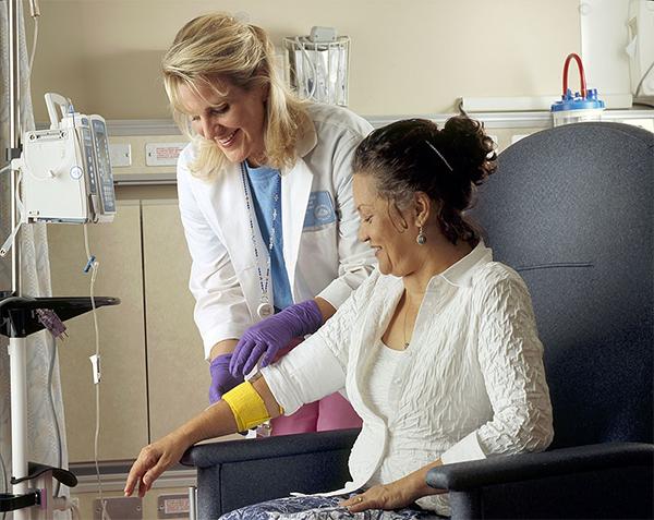 nurse bandages chemotherapy patient