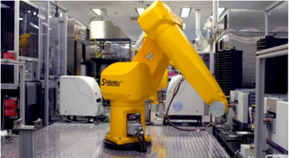 Lab facility with large yellow robotic device swinging across vast arrays of cell trays to assay drug combinations