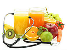 Glasses of juice and pieces of fruit with a stethoscope