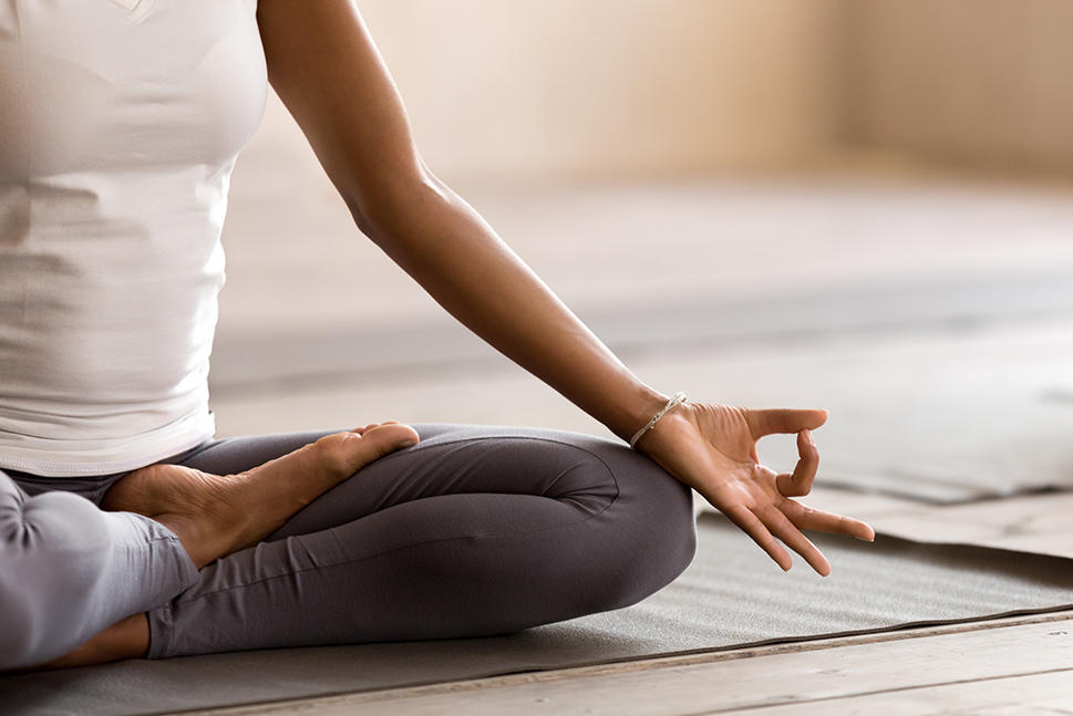 Woman sitting in a yoga pose