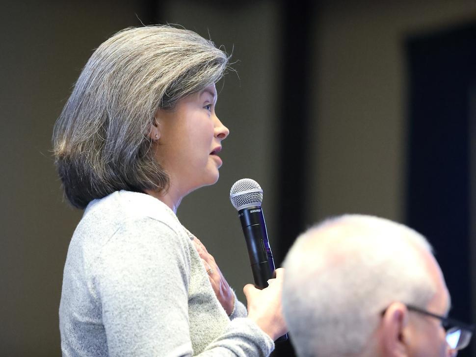Photo of Amanda Haddock addressing attendees of the CCDI symposium.