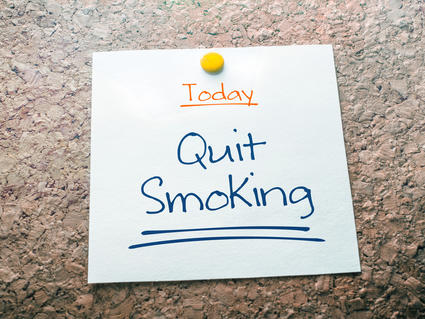 Note tacked to a bulletin board with the words Today, Quit Smoking