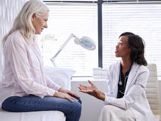 Mature Woman In Consultation With Female Doctor
