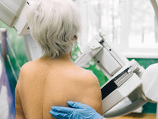 Senior woman having a mammography scan