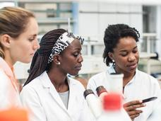 Three female scientists in a lab